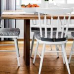Between the white chairs the wooden table and our Brooklynhellip
